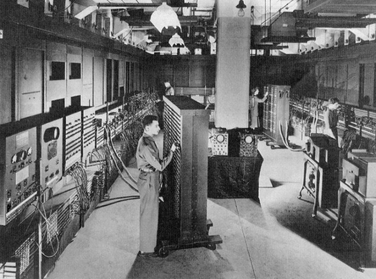 A man operating a vintage computer.